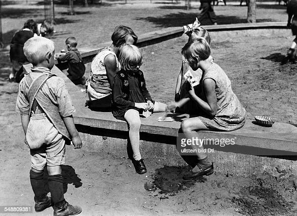 Germany Free State Prussia Berlin Berlin Children playing cards undated Photographer PresseIllustrationen Heinrich Hoffmann Published by 'Tempo'...