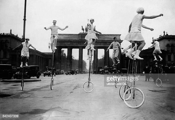 Germany Free State Prussia Berlin Berlin Equilibrists Special performance of a unicycle troupe at Pariser Platz in front of Brandenburg Gate Berlin...