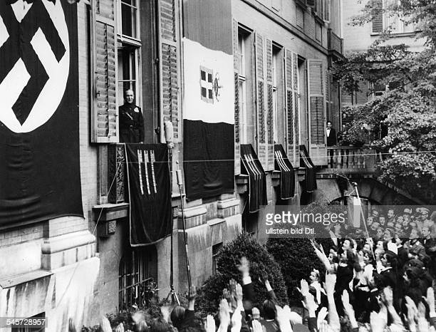 Germany Free State Prussia Berlin Berlin Excited crowd of people showing the Hitler salute while ambassador Alfieri is seen at a window of the...