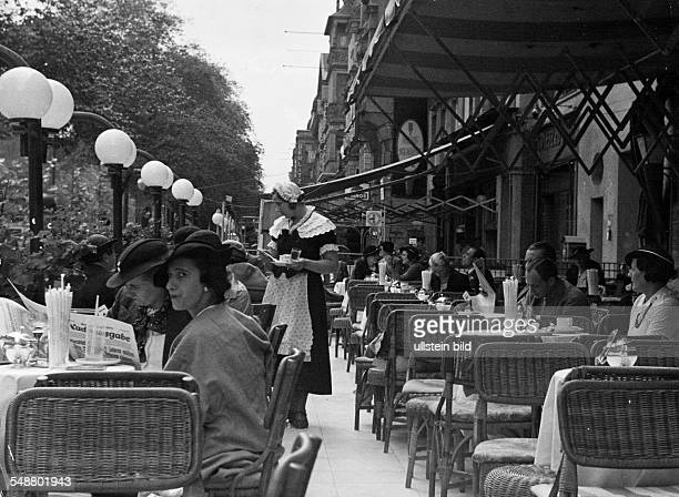 Germany Free State Prussia Berlin Berlin Guests sitting outside in the Cafe Kranzler at the Kurfuerstendamm 1938 Photographer Heinz von Perckhammer...