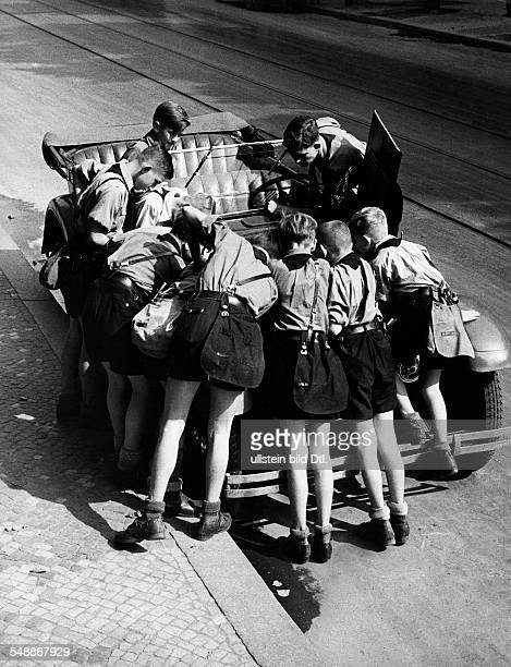 Germany Free State Prussia Berlin Berlin Hitler Youth Boys have a close look at a car motor Photographer Herbert Hoffmann Published by 'Koralle'...