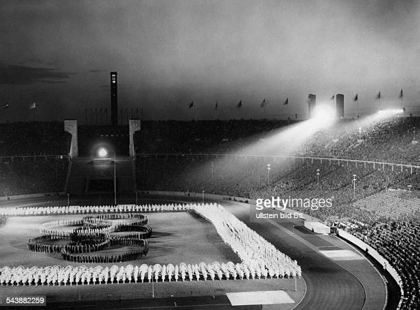Germany Free State Prussia Berlin Berlin Olympic Games 1936 scene during the opening ceremony in the evening Hundreds of people are forming the...