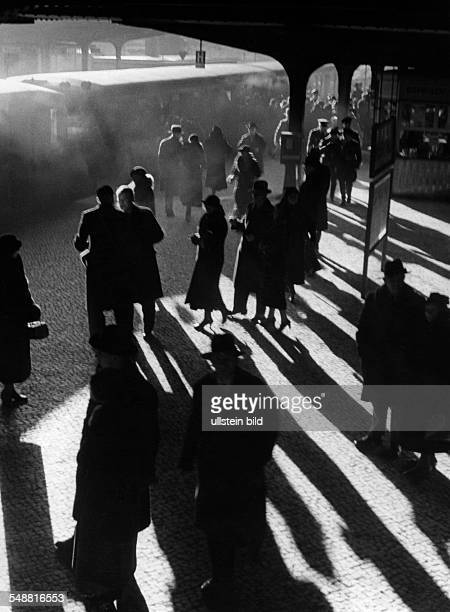 Germany Free State Prussia Berlin Berlin People at a railway station in Berlin in front lighting 1936 Photographer Wolf Strache Vintage property of...