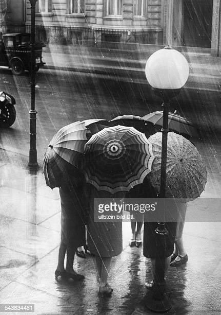 Germany Free State Prussia Berlin Berlin: Rain in Berlin - Women with ambrellas standing in a circle - undated- Vintage property of ullstein bild