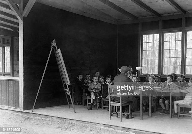 Germany Free State Prussia Berlin Berlin rural school in Charlottenburg in wooden huts in bad weather 1919 Photographer Frankl Published by 'Die...