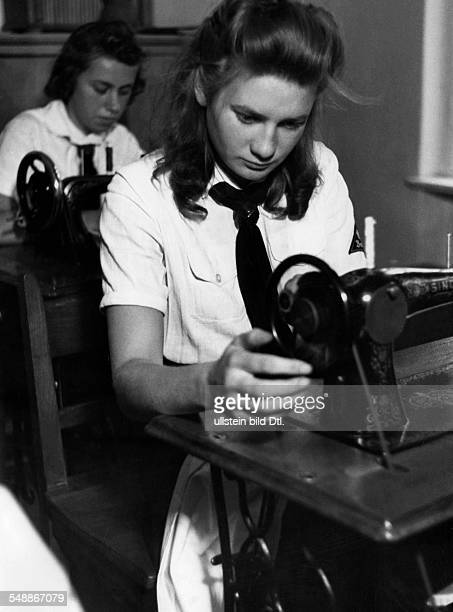 Germany Free State Prussia Berlin Berlin Sewing room of the League of German Girls Photographer Herbert Hoffmann Published by 'Berliner Volkszeitung'...