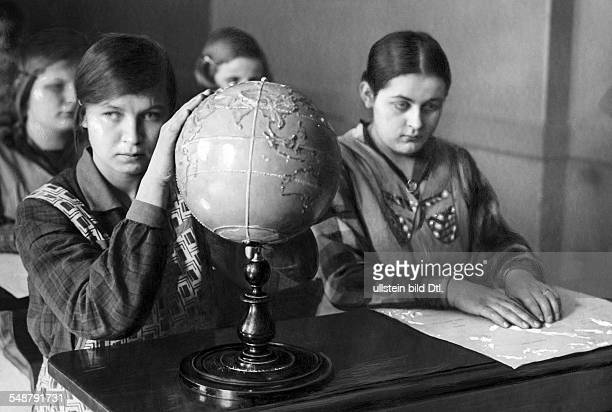 Germany Free State Prussia Berlin Berlin State Institution for the Blind in BerlinSteglitz pupils fumbling a globe with relief 1930 Photographer...