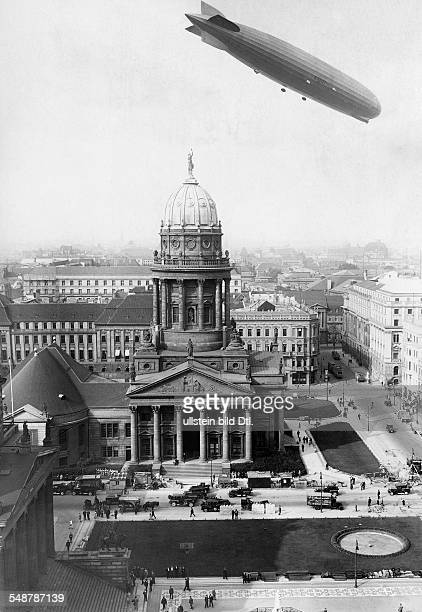 Germany Free State Prussia Berlin Berlin The airship 'Graf Zeppelin' LZ127 over the Gendarmenmarkt view on the Franzoesischer Dom about 1930...