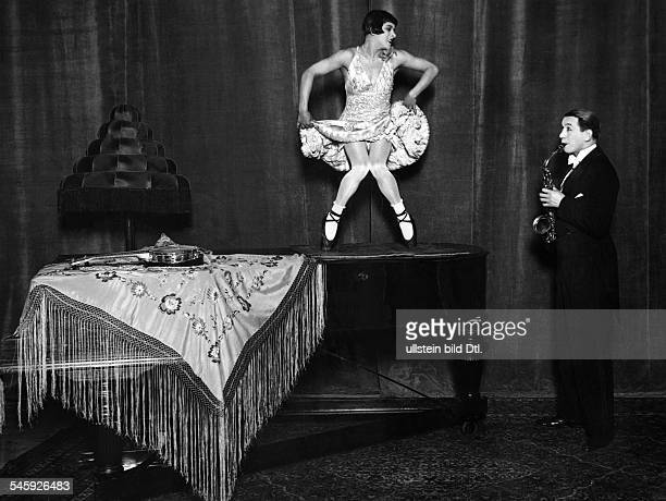 Germany Free State Prussia Berlin Berlin Vaudeville show The dance comedians '2 Hugos' dance on a grand piano play sax in 'Universum' theater 1929...
