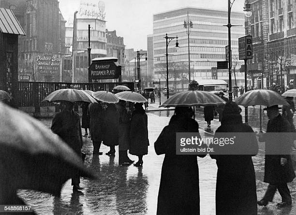 Germany Free State Prussia Berlin Berlin View of the square on a rainy day in the foreground the entry to the subway station Potsdamer Platz in the...