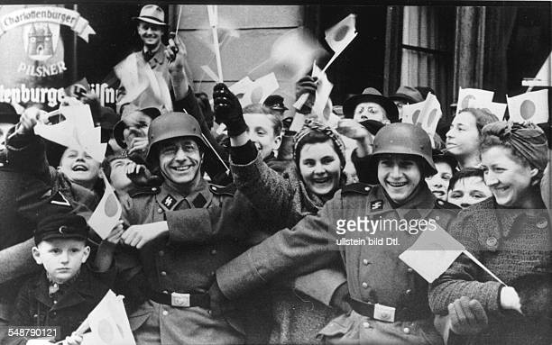 Germany Free State Prussia Berlin Crowd cheering and waving small Japanese flags as the convoy of the Japanese foreign minister Matsuoka is passing...