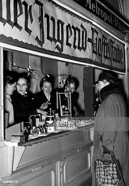 Germany Free State Prussia Berlin League of German Girls offers self made toys during a winter relief ' Kriegswinterhilfswerk ' Photographer Herbert...