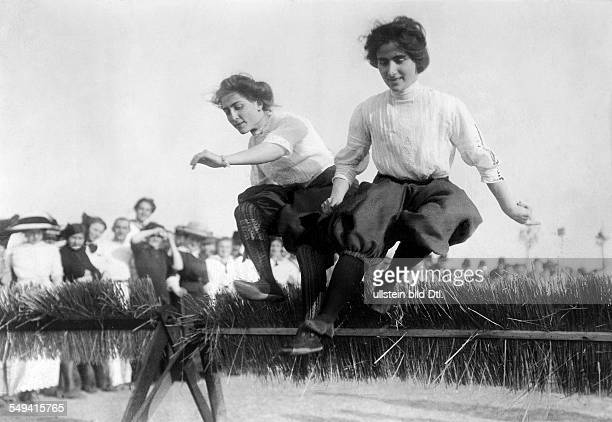 Germany Free State Prussia Berlin : Track and field race, hurdling: 2 women of the Allgemeine Turnerschaft Charlottenburg sports club jumping over...