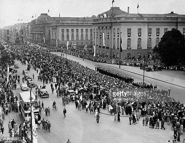 Germany Free State Prussia Brandenburg Province Berlin Olympic Games 1936 Crowd of people in the street ' Unter den Linden ' during a parade of the...