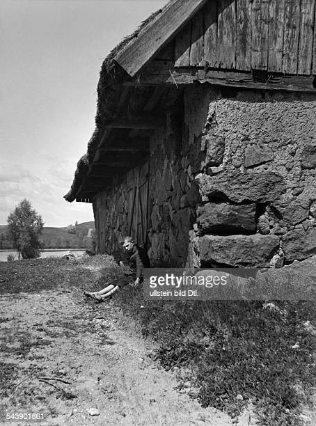Germany Free State Prussia East Prussia Province Masuria country boy behind a thatched stonehouse 1934 Photographer Seidenstuecker Vintage property...