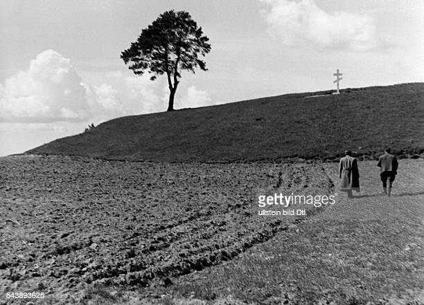 Germany Free State Prussia East Prussia Province Masuria field with a russian grave on a hill in the background 1934 Photographer Seidenstuecker...