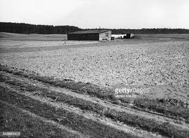 Germany Free State Prussia East Prussia Province Masuria field with farmhouse in the background 1934 Photographer Seidenstuecker Vintage property of...