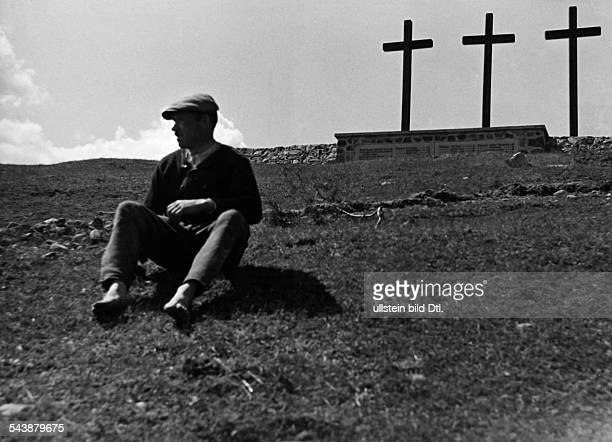 Germany Free State Prussia East Prussia Province Masuria man sitting on a hill with a memorial 1935 Photographer Seidenstuecker Published by...