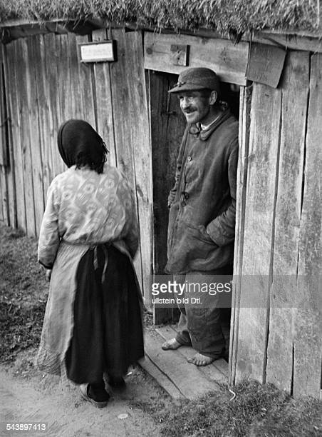 Germany Free State Prussia East Prussia Province Masuria poor farmer with no shoes on at the frontdoor of a farmhouse 1935 Photographer...