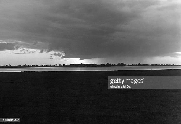 Germany Free State Prussia East Prussia Province Masuria rain cloud over the Kessel lake 1934 Photographer Seidenstuecker Vintage property of...
