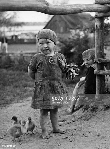 Germany Free State Prussia East Prussia Province Masuria two girls with chicks 1933 Photographer Seidenstuecker Published by 'Berliner Illustrirte...