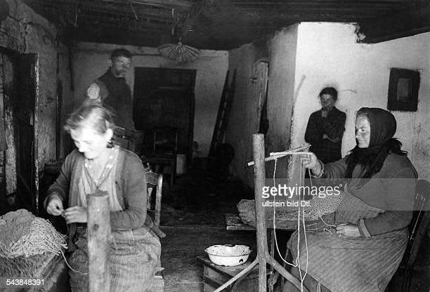 Germany Free State Prussia East Prussia Province Masuria view of a room in a poor farmer's house The women are probably preparing filament for making...