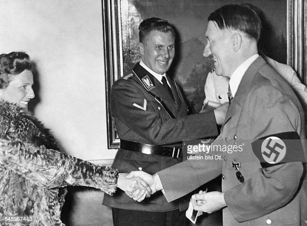Germany Free State Prussia: Leni Riefenstahl congratulating Adolf Hitler to his 49th birthday| middle: Alfred Bormann - - Photographer:...