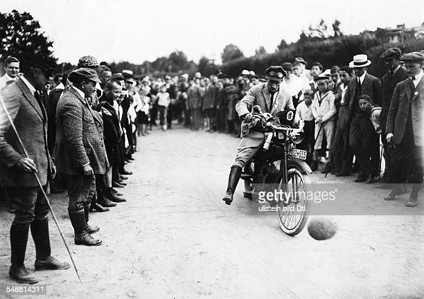 Germany Free State Prussia Pomerania province Sopot Zoppot sports week motorcycle skill test organised by the Danzig Motorcycle Club a man kicking...