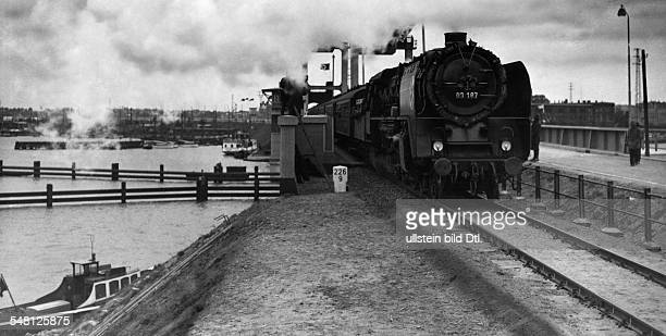 Germany Free State Prussia Pomerania province Stralsund First train passes the ' Ruegendamm ' after the opening of the bridge Photographer...