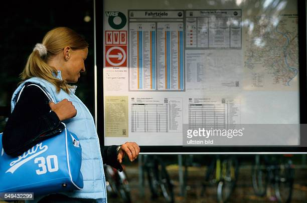 Free time A young woman at a station she is looking at the timetable