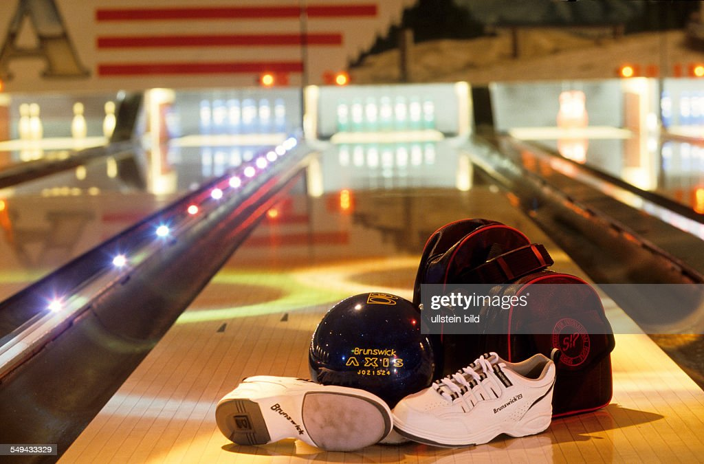 Free time.- At a bowling alley; shoes, ball and rucksack.