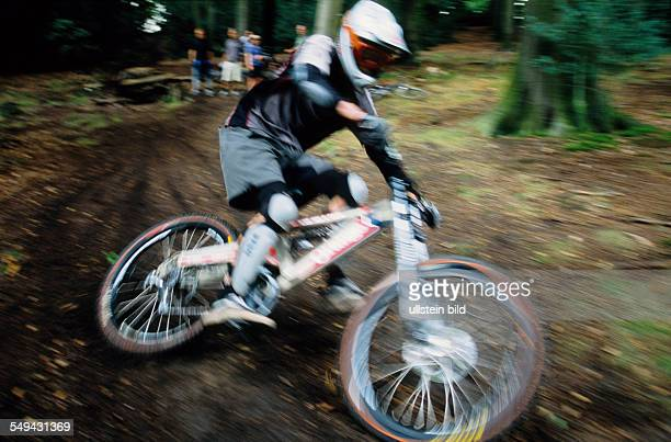 Germany: Free time.- Bicyclists in the wood.