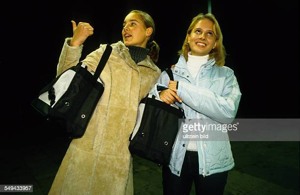Germany: Free time.- Portrait of two young women at night.