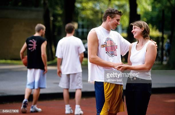 Free time Teenager a couple on a baskatball field