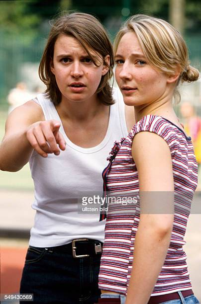 Germany: Free time.- Two woman being amazed.
