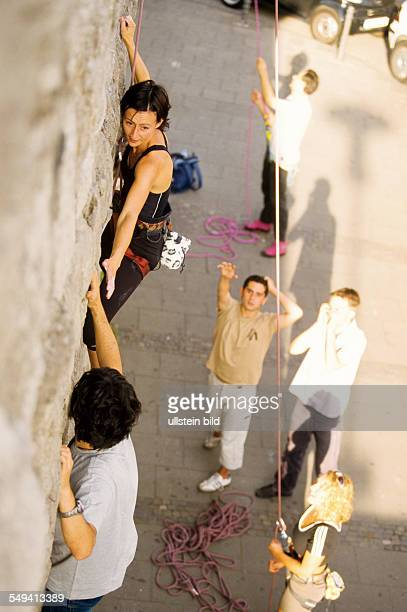 Germany: Free time.- Young persons climbing.