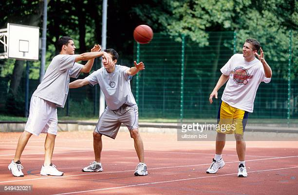 Free time Young persons playing basketball