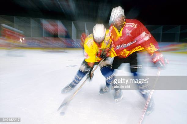 Free time Young persons playing ice hockey