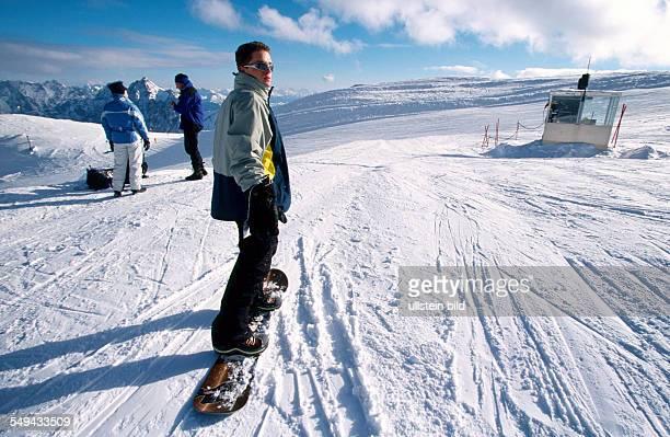 Free time Young persons skiing and snowboarding in the mountains