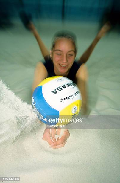 Free time Young woman doing sports indoor beachvolleyball