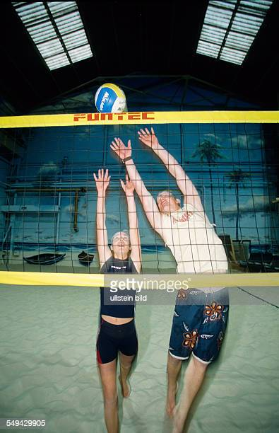 Free time Youth doing sports indoor beachvolleyball