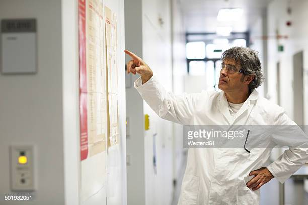 Germany, Freiburg, Scientist in laboratory corridor
