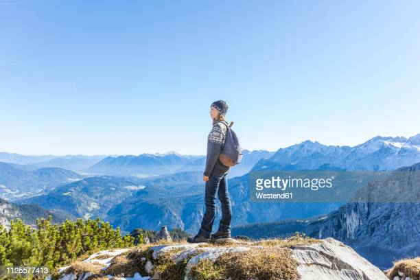 germany, garmisch-partenkirchen, alpspitze, osterfelderkopf, female hiker on viewpoint looking at view - bavarian alps stock pictures, royalty-free photos & images
