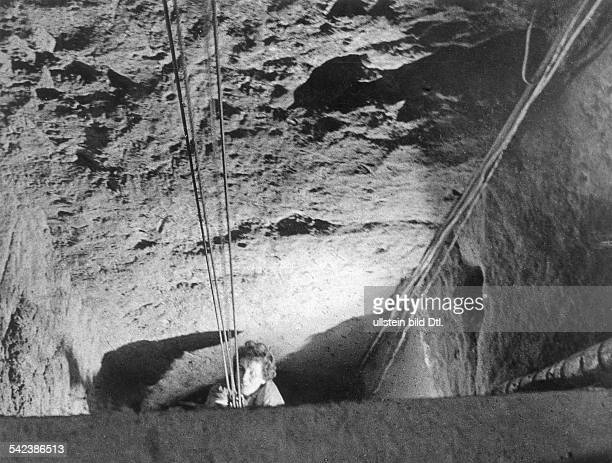 Germany / GDR Berlin 57 people escaped through a tunnel at Bernauer Strasse A woman in the tunnel 1964