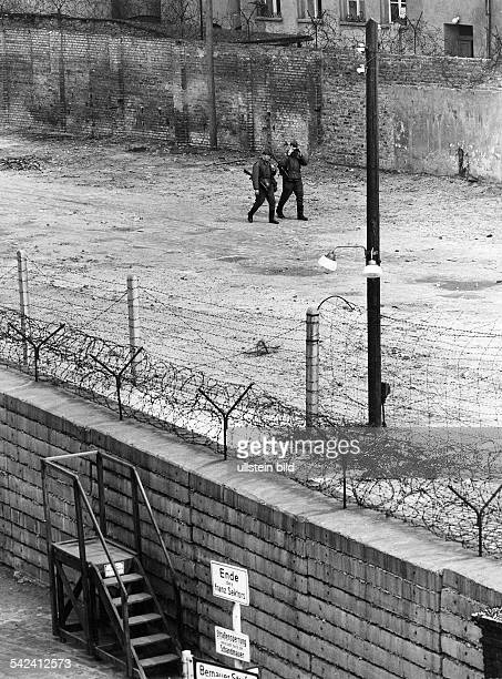 Germany / GDR Berlin EastGerman border guards with guns at the death zone at the wall Bernauer Strasse about 1967