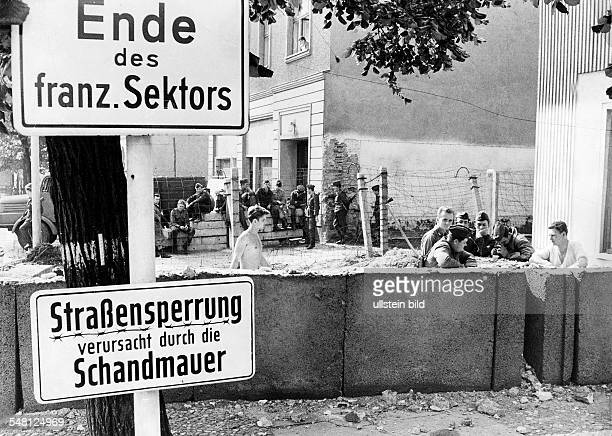 EastGerman policemen moving the wall at Bernauer Strasse 1973