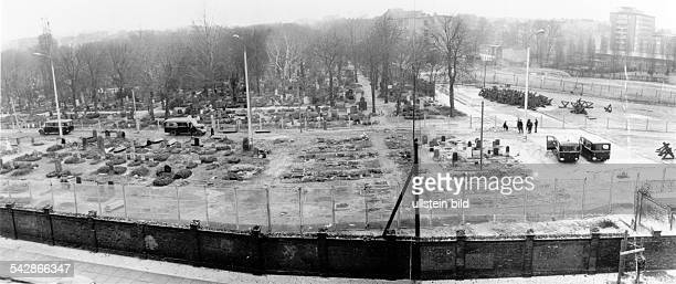 Germany / GDR Berlin Graveyard at the eastside of Bernauer Strasse Graves are moved in order to extend the wall 1967