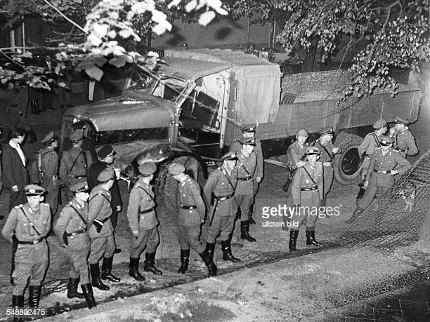 Germany / GDR Berlin Three EastBerlin citizens tried to break through the wall with a mail van at Bouchéstrasse in Neukoelln EastGerman policemen in...