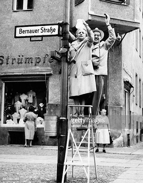 Germany / GER Berlin The building of the wall WestBerlin citizens waving to EastBerlin Bernauer Strasse 1961