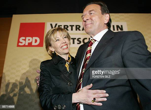 German Chancellor Gerhard Schroeder embraces his wife Doris SchroederKoepf during the election night at the Social Democratic Party headquarters in...